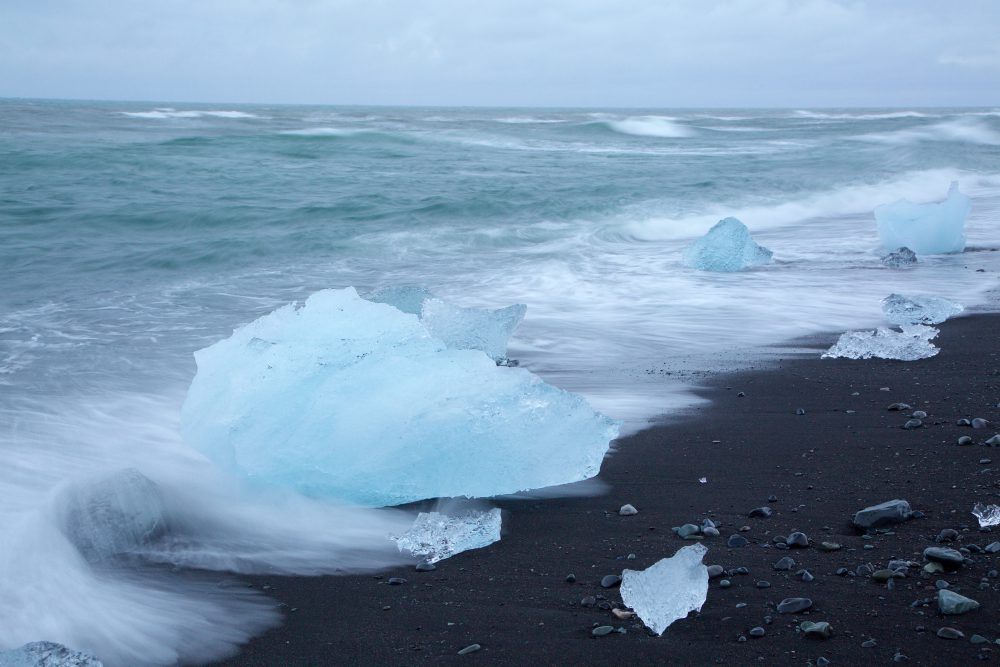 Closeup of glaciers and beach in Jokulsarlon Lagoon