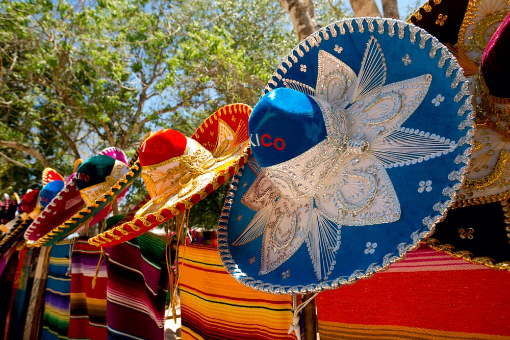 Body- colorful Mexican sombreros and ponchos lined up outdoors