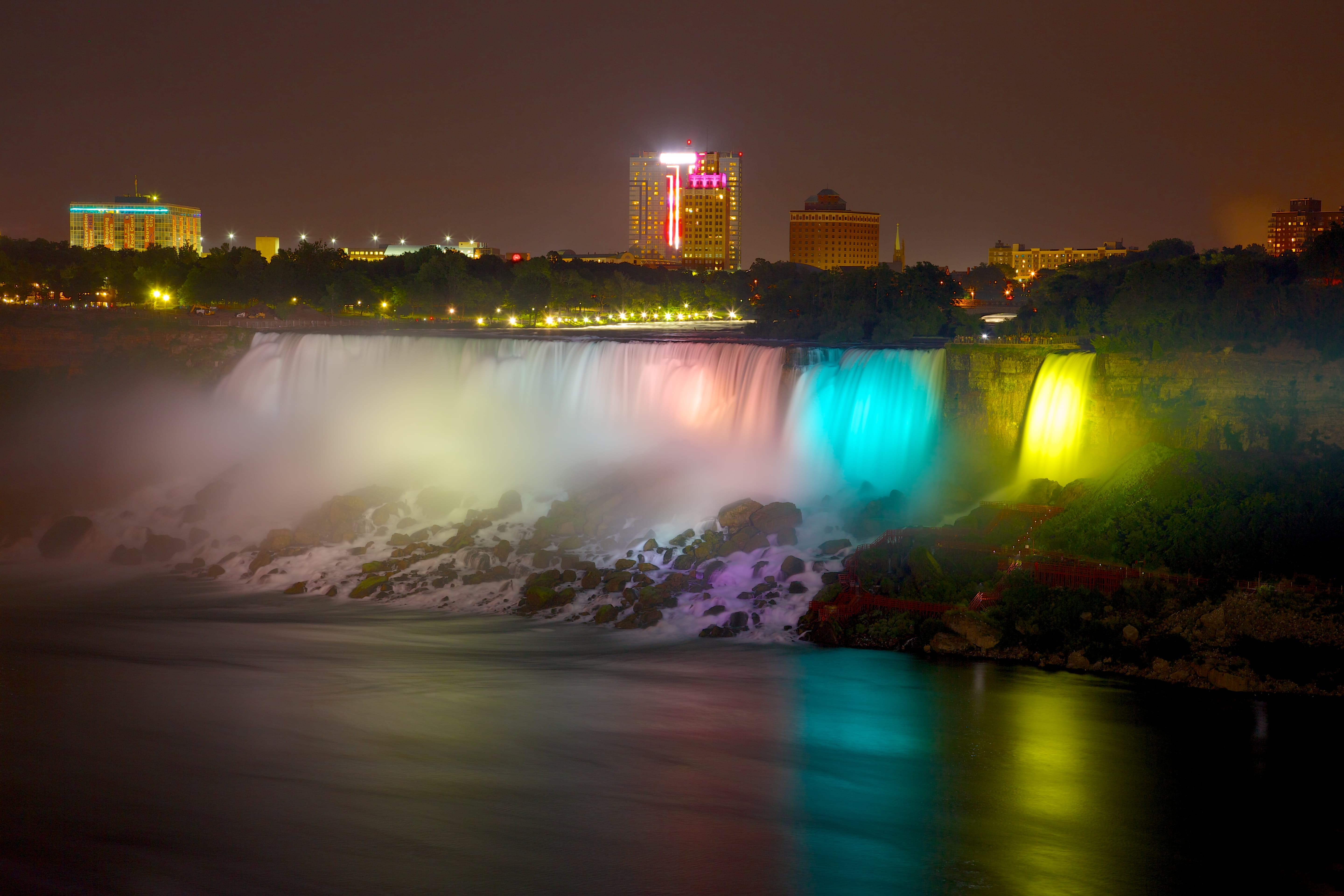 The falls are lit at night.