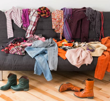 Thumbnail- What to wear Messy colorful clothing on a sofa.