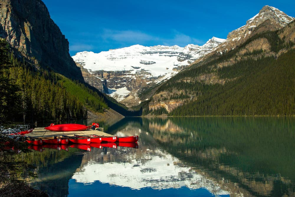 lake, lake louise, canoes on lake, lake and moutnains