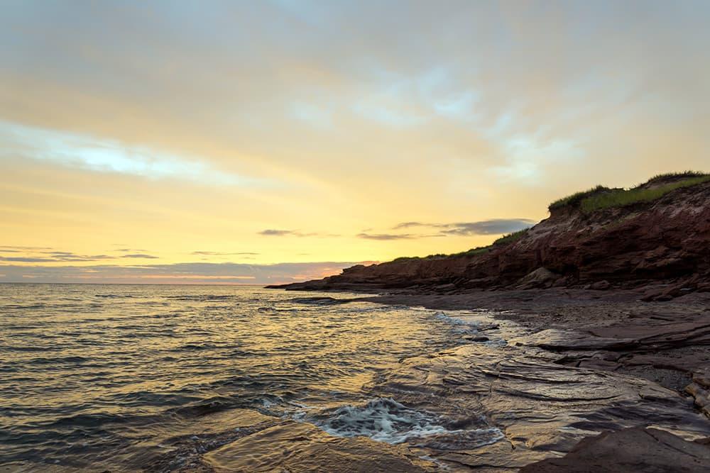 Alt text: Morning light over Cavendish Beach on Prince Edward Island