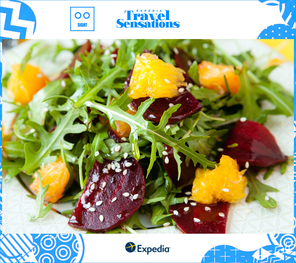 Picture closeup of a fresh beet, orange, and arugula salad