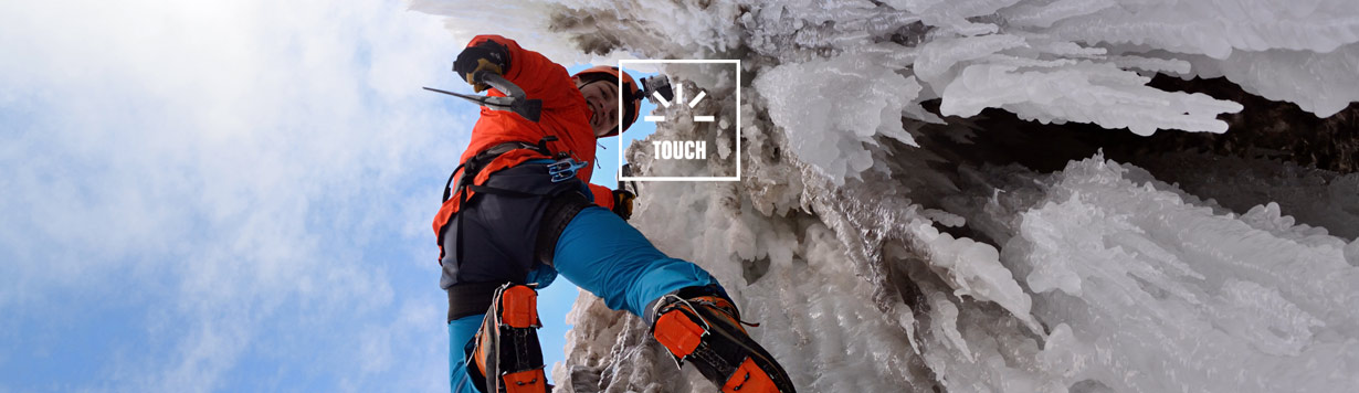 Ice climber scales a frozen waterfall