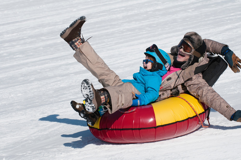 Mother and child tubing, which you can find in London, Ontario--a top winter destination