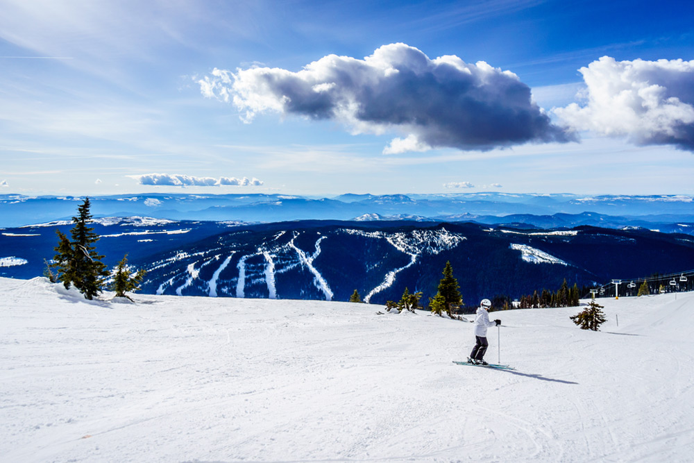 Skier on Sun Peaks, BC mountain, a top destination for Canadian winters