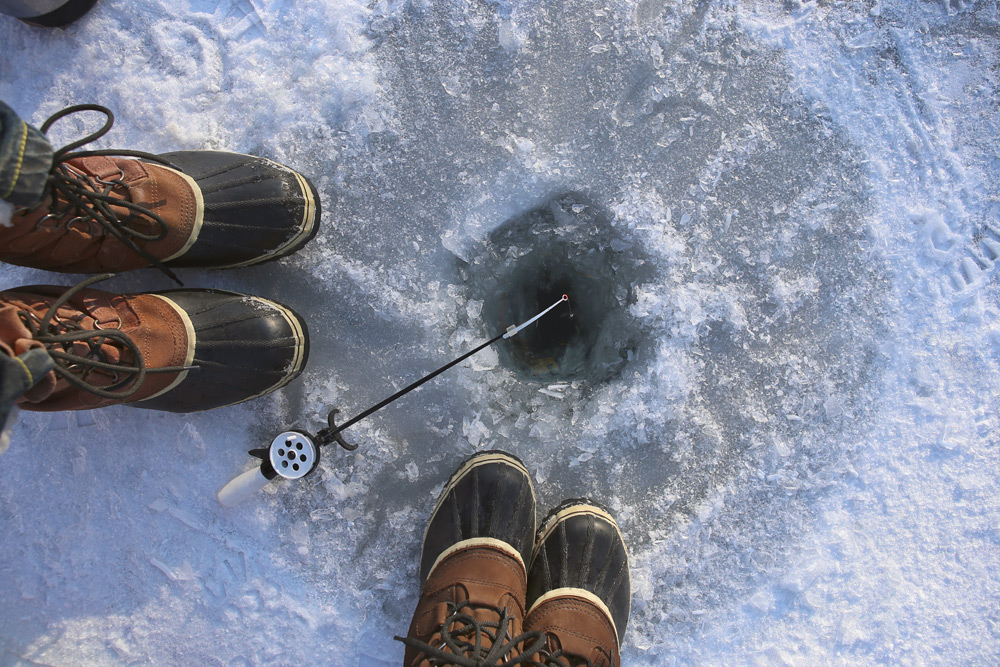 Ice fishing, a top activity in Cold Lake, Alberta