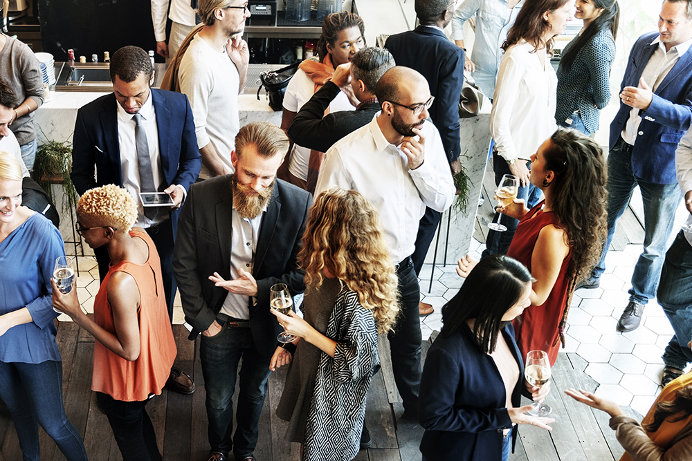 Professionals mingle at a business event
