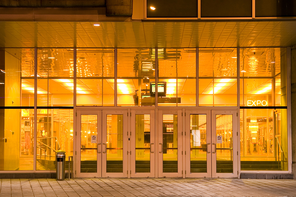 Orange-tinted glass entryway into the northern doors of the Montreal Convention Centre