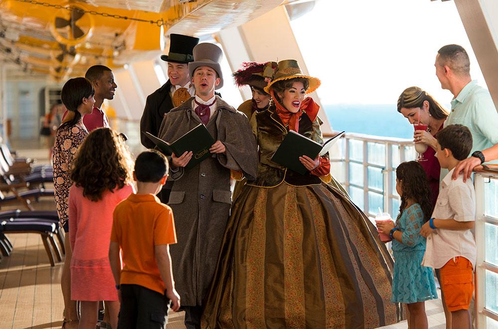 Kids singing along with carolers at Disney Dream