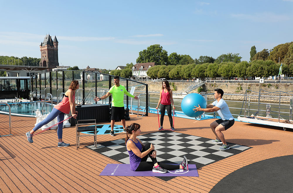 Cruise guests working out in the sundeck of AmaMora