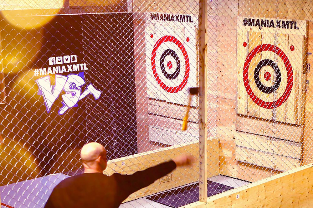 Man throws an axe at Maniax, one of the best bachelor party ideas in Montreal