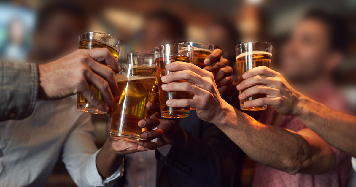 Guys cheers with pints of beer during a bachelor party in Montreal