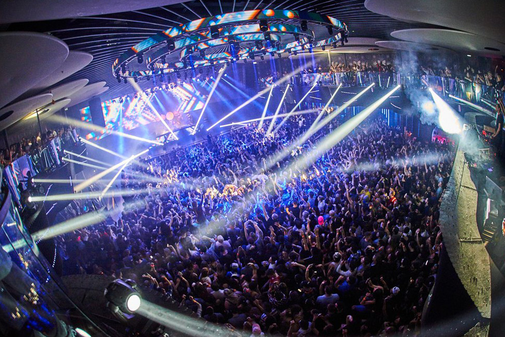 Club goers dance the night away in a big nightlife--a top activity for a bachelor party in Toronto