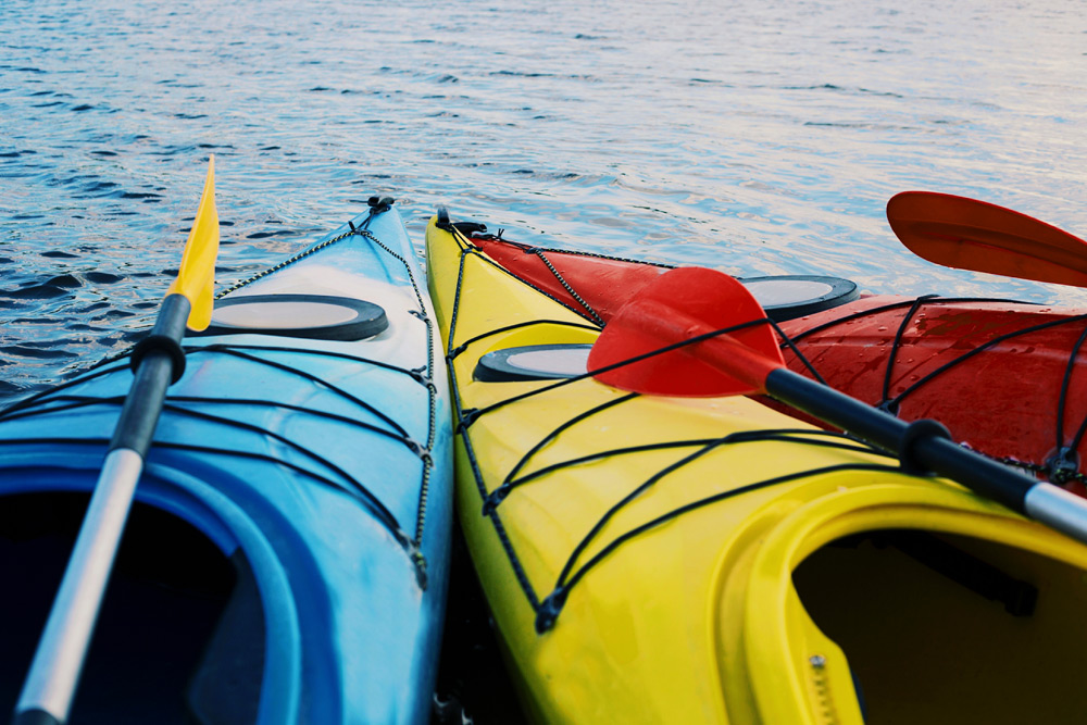 A group of kayaks get ready to launch into the water, a top Montreal bachelor party activity