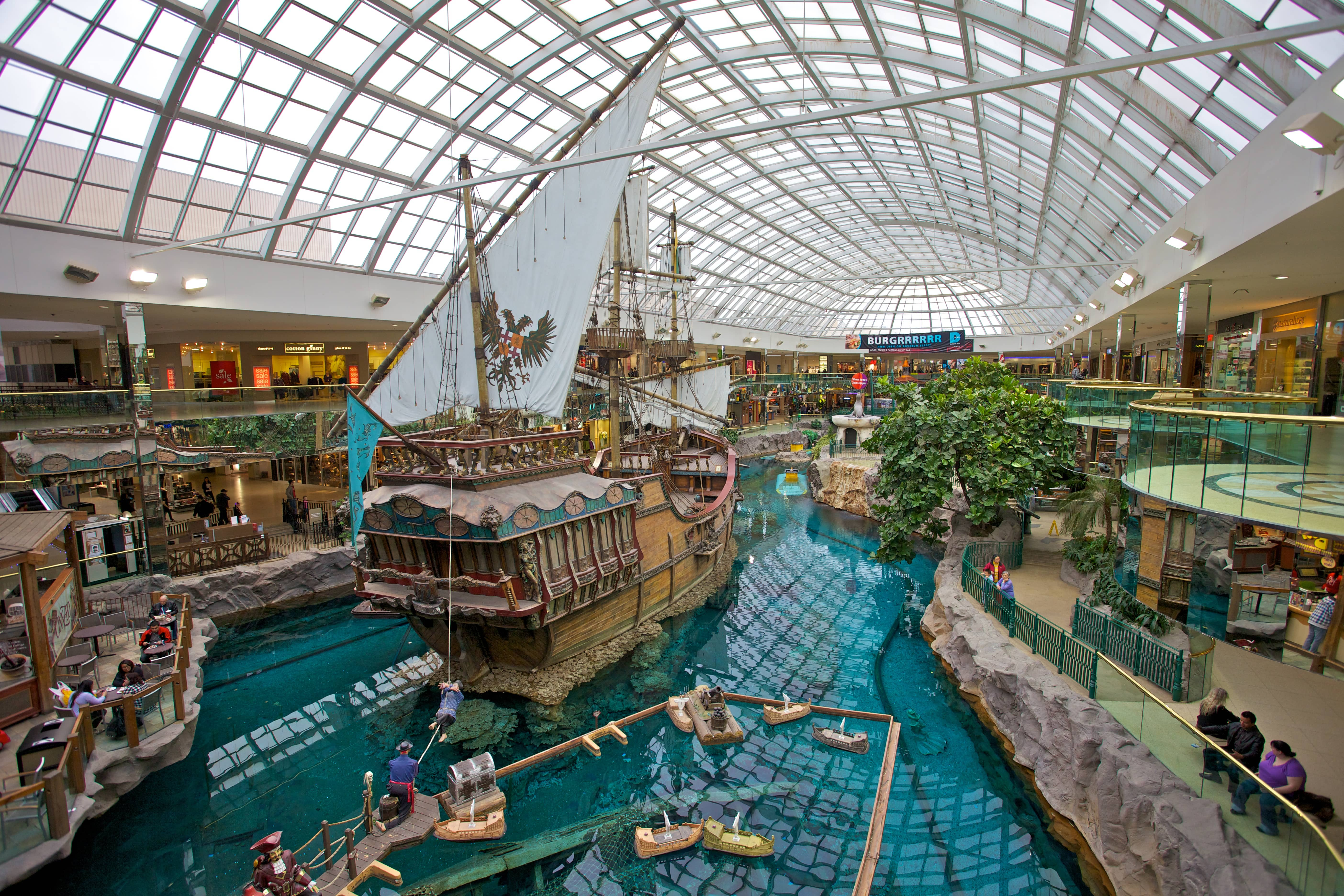 View overlooking a pirate ship ride in the middle of shops and restaurants at the West Edmonton Mall