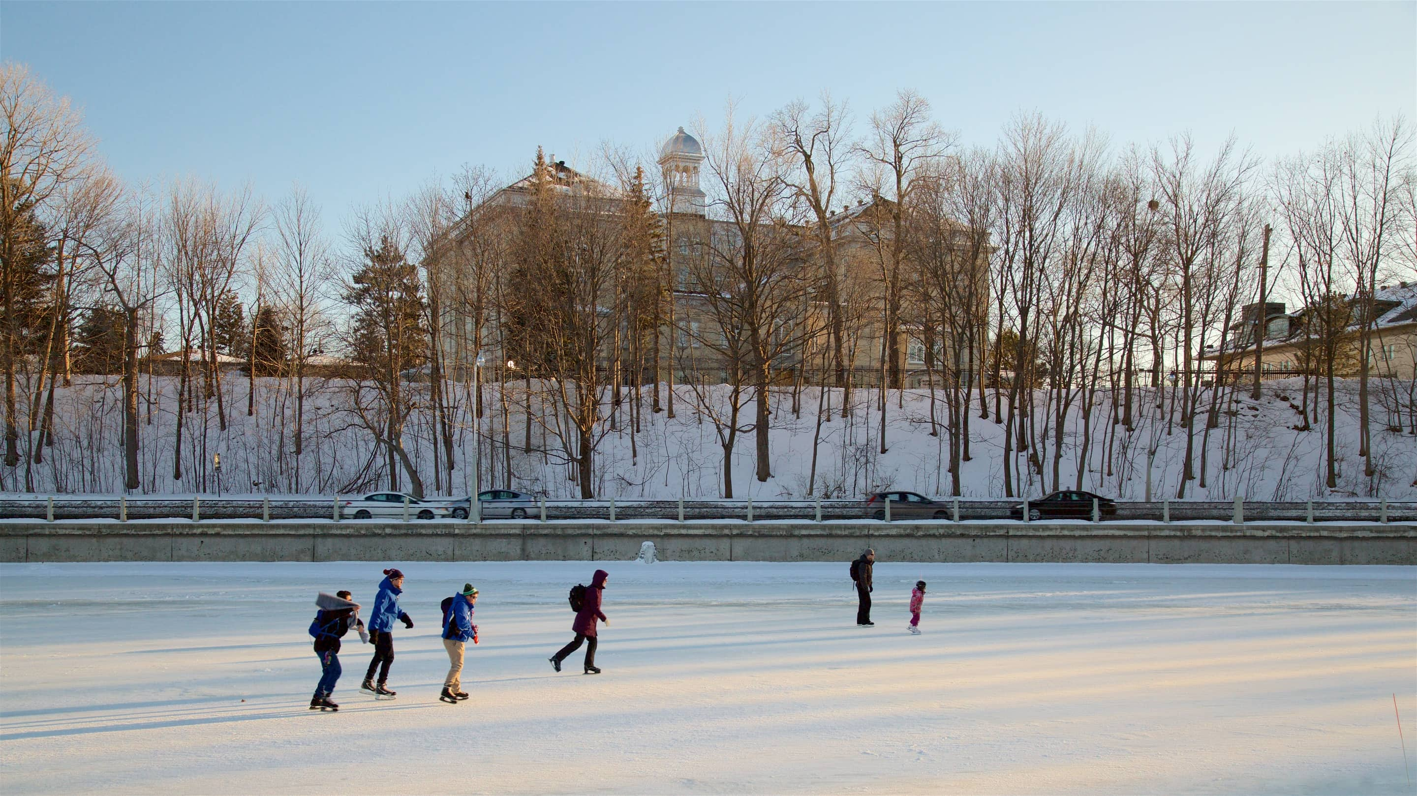 People ice skating on a frozen canal