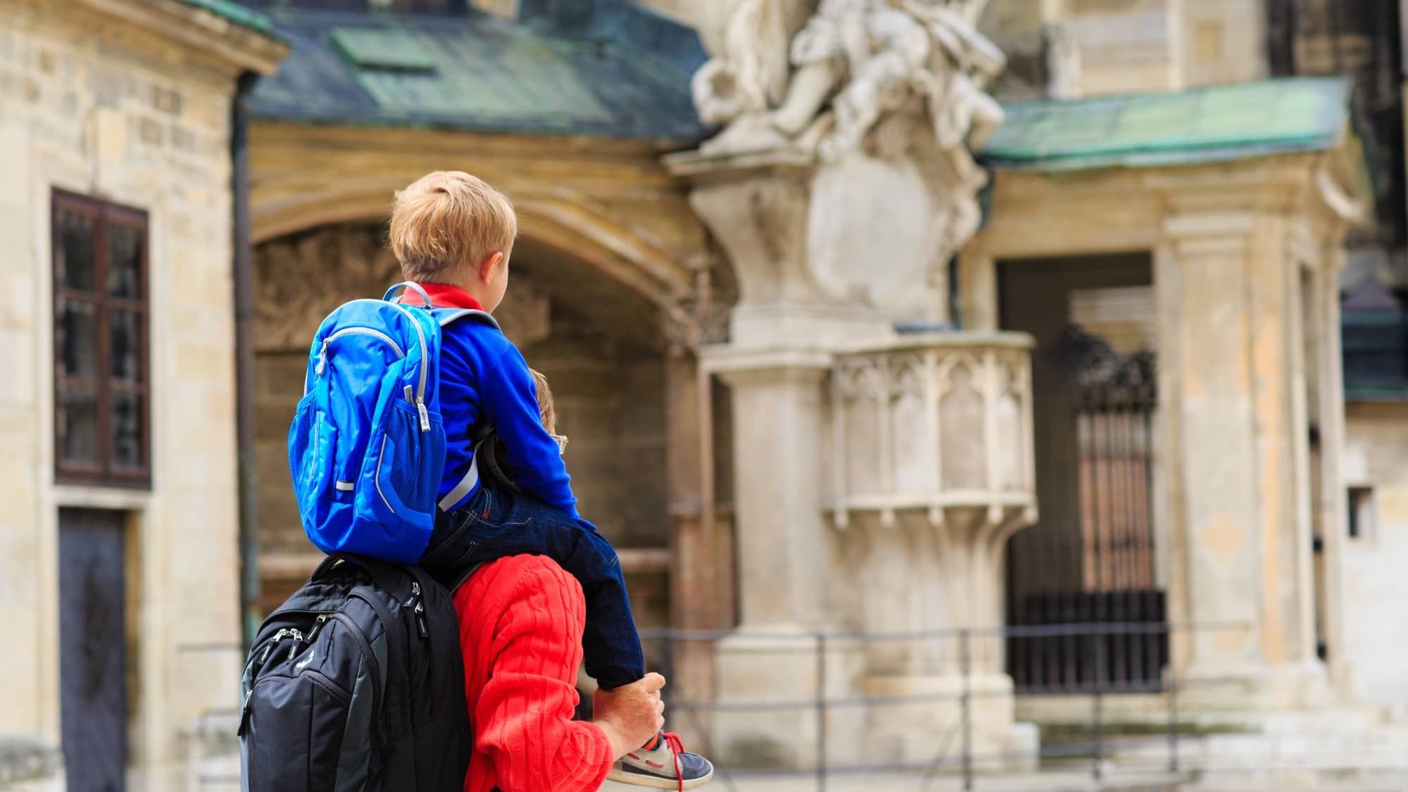 Father with son on his shoulders visiting Europe