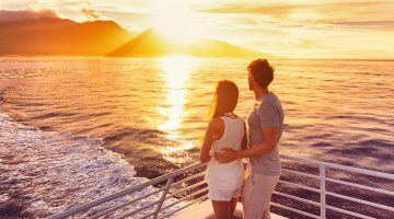 Couple-at-Romantic-Cruise-sunset