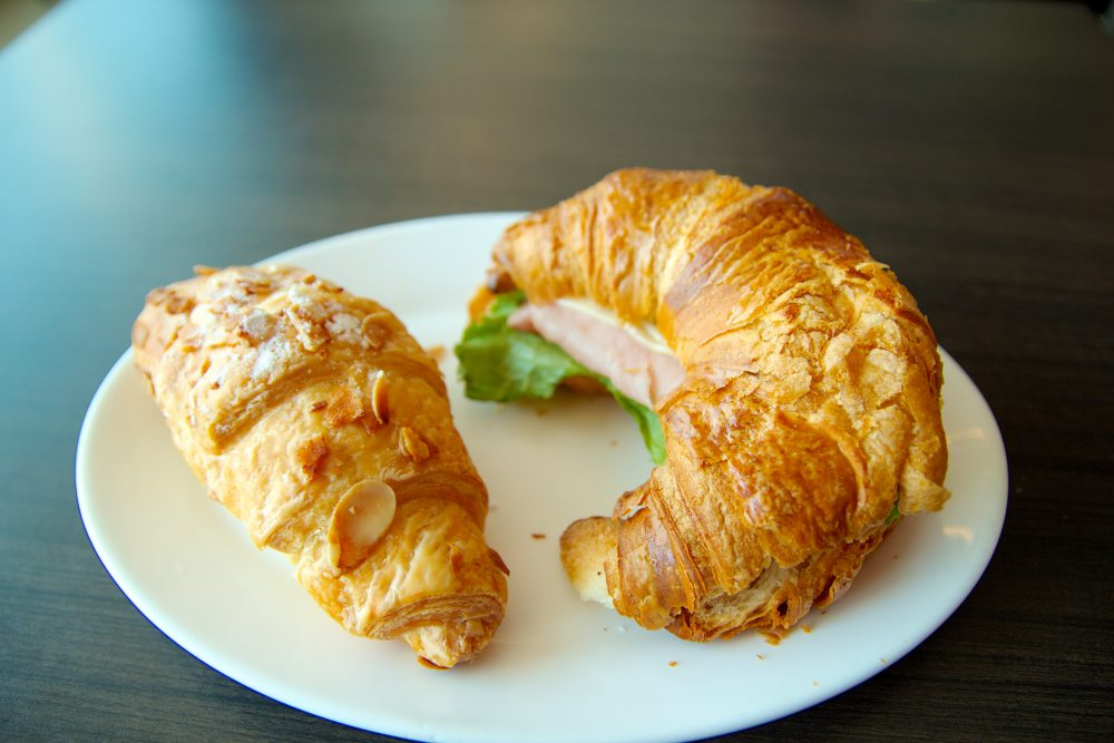 Two croissant sandwiches on a plate