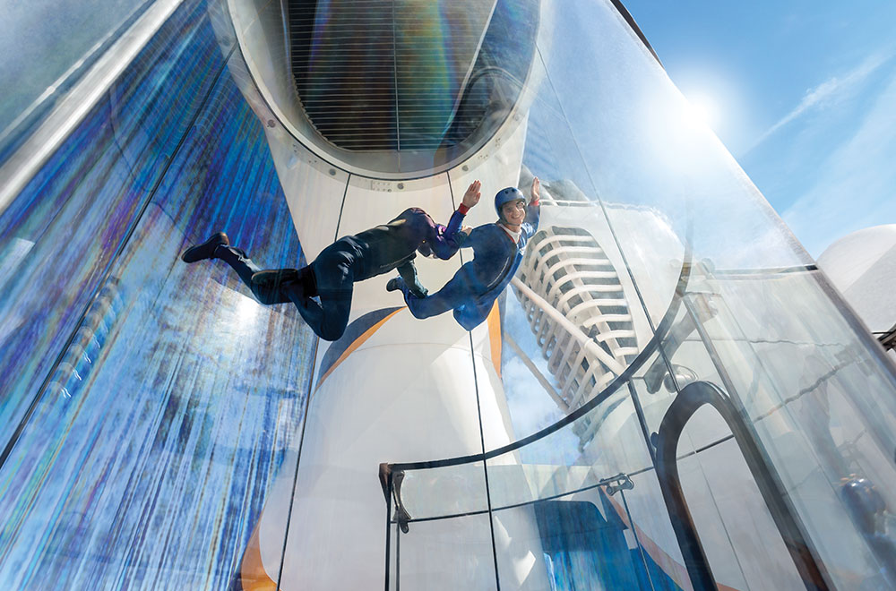 Guests having fun at the Skydiving simulator