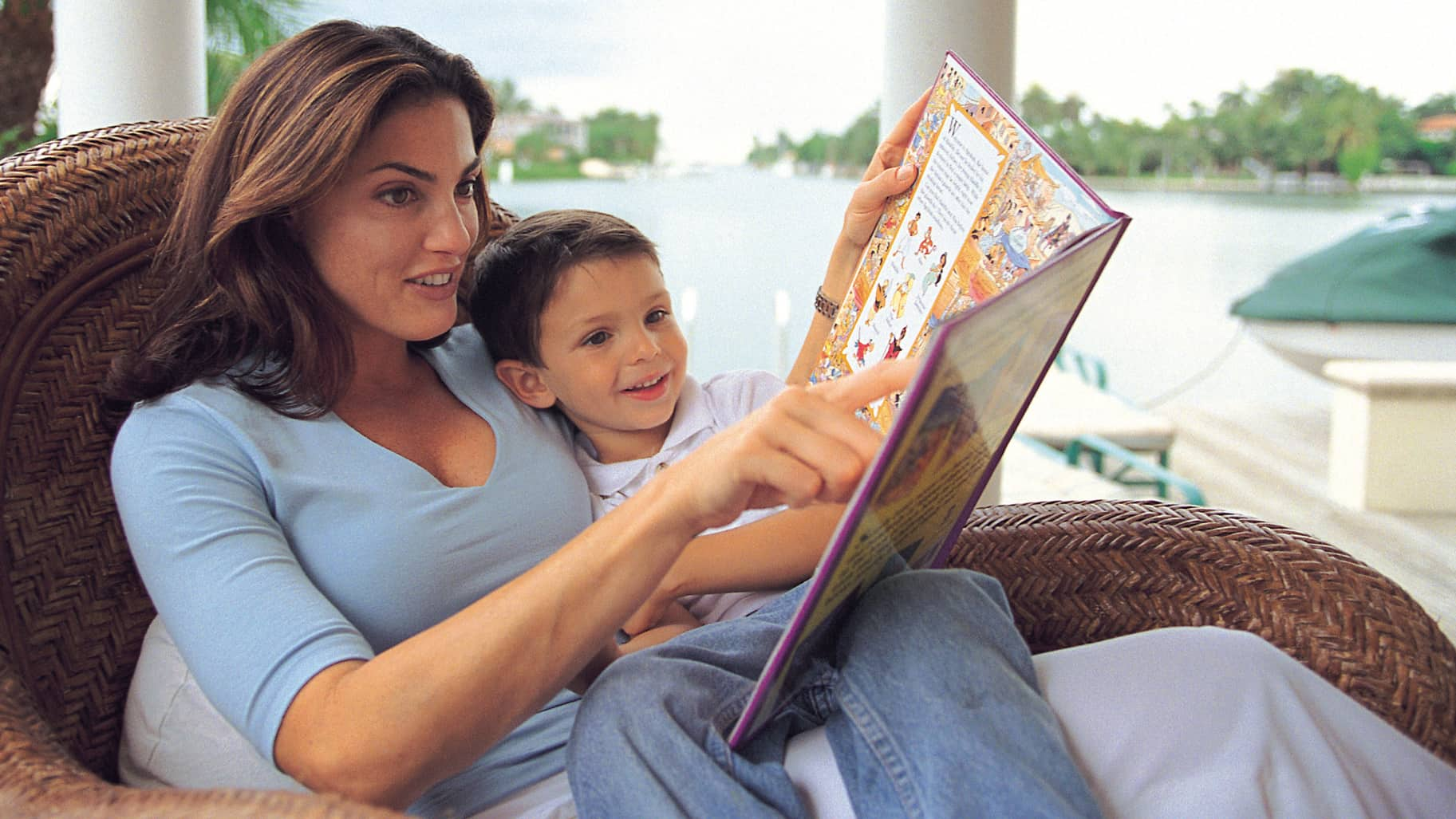 Mother and son reading about foreign countries and cultures